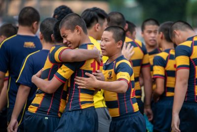 ACS(I) players hugging each other in tears as they celebrate their 19-7 victory over St Andrew's Secondary School in the C Division rugby Cup final. (Photo 1 © Jared Khoo/Red Sports)