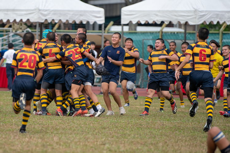 ACS(I) players running onto the field to celebrate their 19-7 victory over St Andrew's Secondary School. (Photo 1 © Jared Khoo/Red Sports)