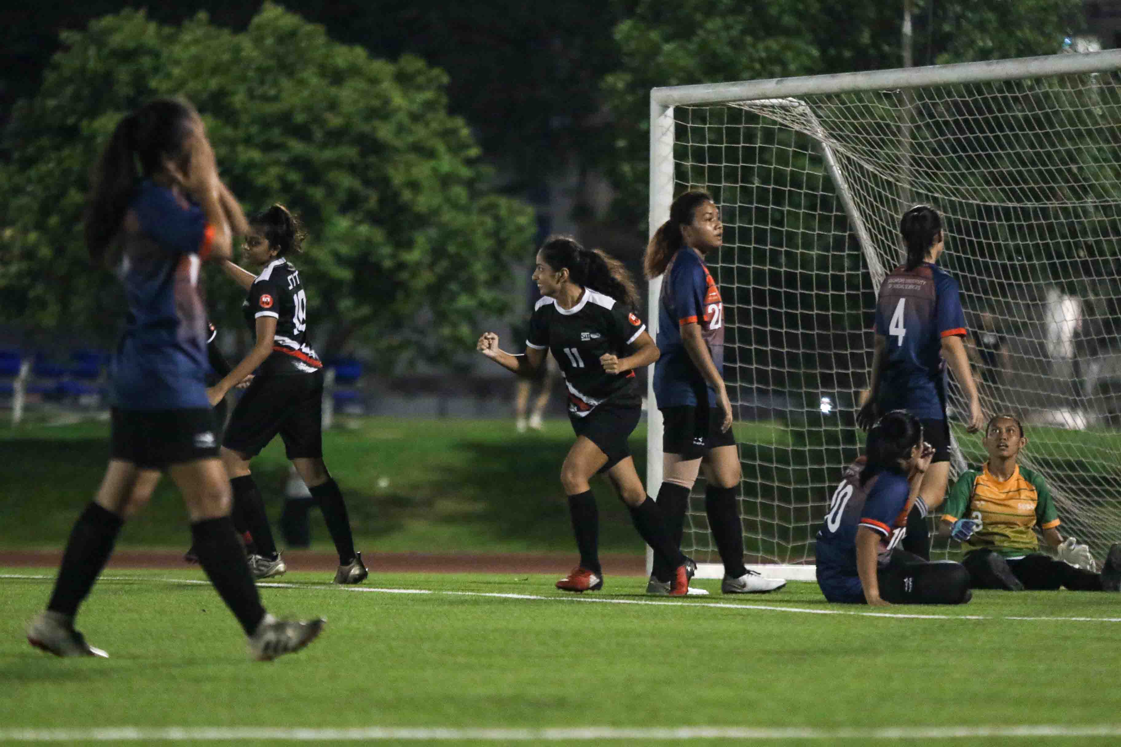 Vinita Sheri (SIT #11) celebrates after scoring to give SIT a 2-0 lead. (Photo 7 © Clara Lau/Red Sports)