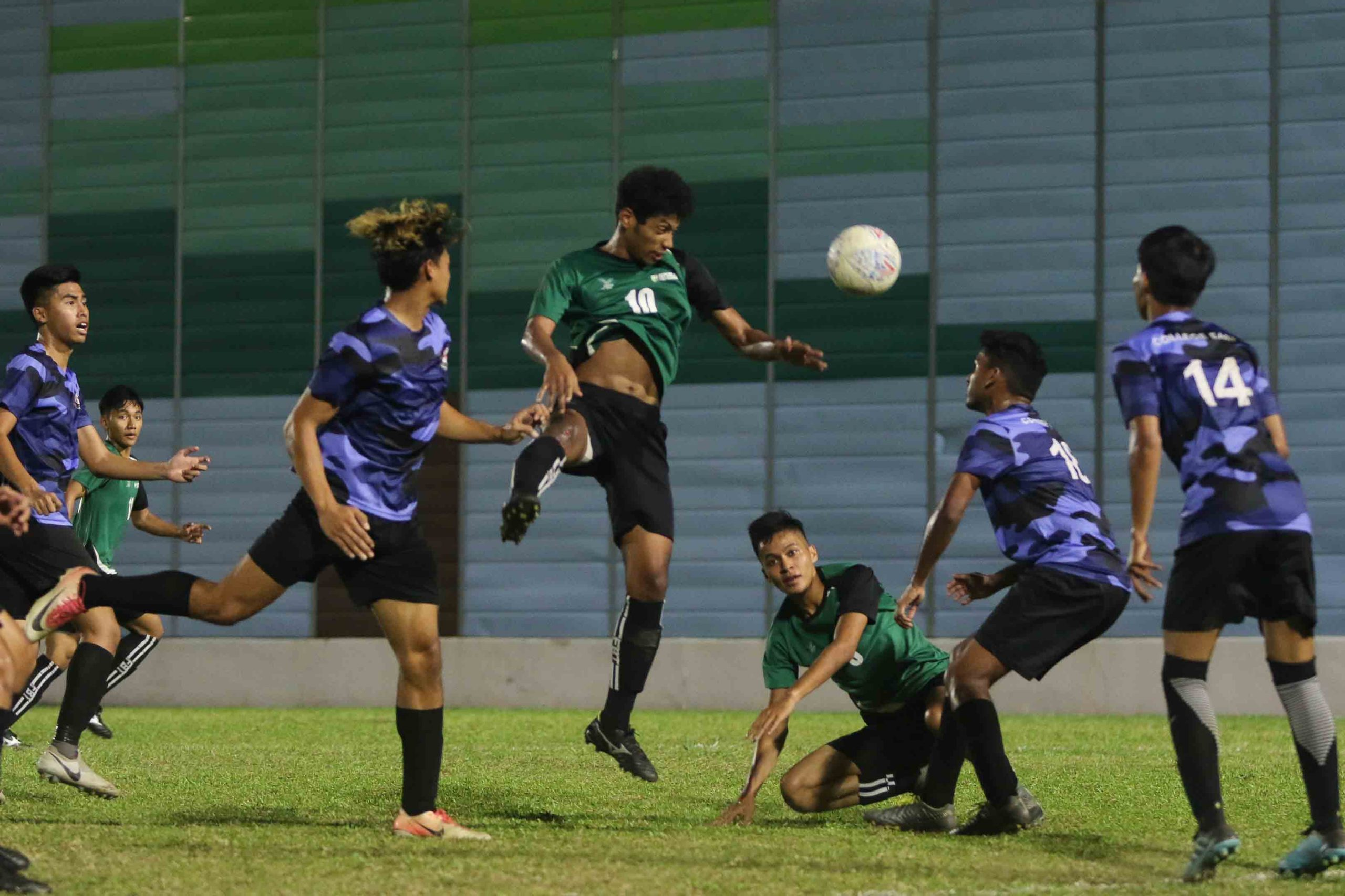Muhammad Danial (RP #10) rises to head the ball goal-wards from a corner kick. (Photo 3 © Clara Lau/Red Sports)
