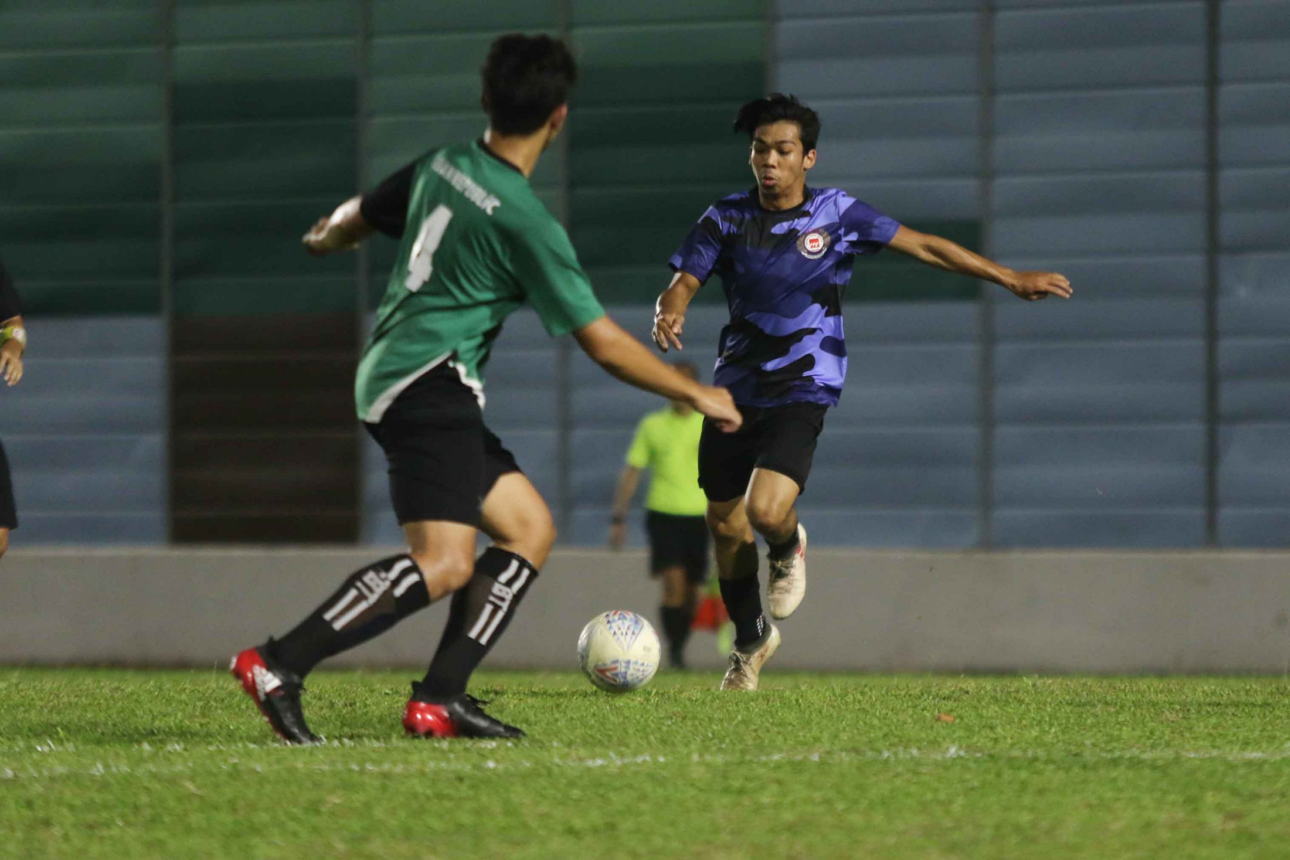Khairul Hairie (ITE #8) lining himself up for a shot at goal. (Photo 4 © Clara Lau/Red Sports)