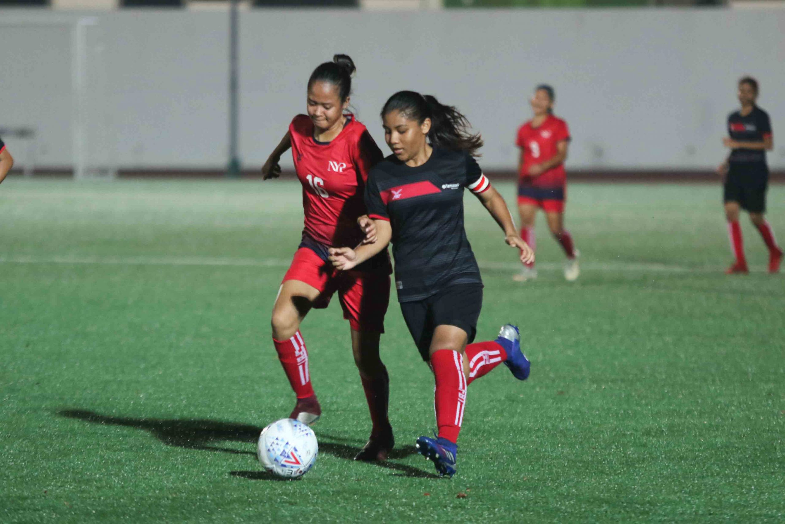 TP captain Mira Ruzana (#8) dribbles the ball down the field chased by Erissa Qistina (NYP #16). (Photo 5 © Clara Lau/Red Sports)