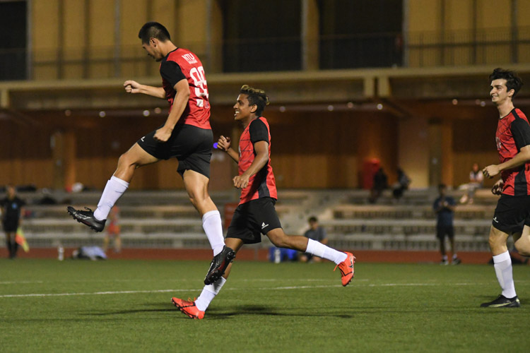 Timothy Chong (NTU #99) celebrating his goal during the match. NTU put up an attacking exhibition to win 6-1 against SMU in their opening IVP Football competition. (Photo 1 © Stefanus Ian/Red Sports)