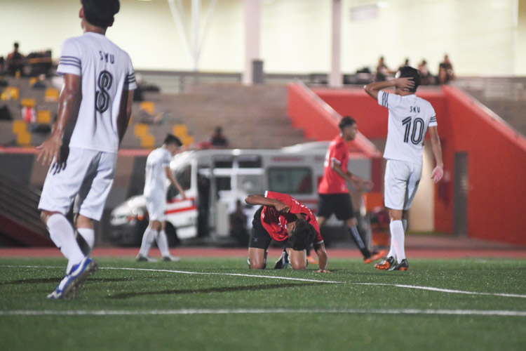 Syukri Noorhaizam (TP #11) beating the ground after missing a chance in front of goal. Temasek Polytechnic cruised to a 5-0 win over Singapore Management University to book their place in the semi-final of the Institute-Varsity-Polytechnic football tournament. (Photo 1 © Stefanus Ian/Red Sports)