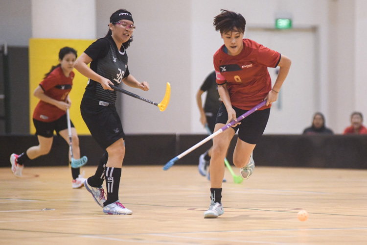 Valerie Ong (TP #9, in red) dribbling past her opponent during a match. In a top-of-the-table clash, NTU cruised to a 5-0 victory over TP to book their place in the semi-final. (Photo 1 © Stefanus Ian/Red Sports) (Photo 1 © Stefanus Ian/Red Sports)