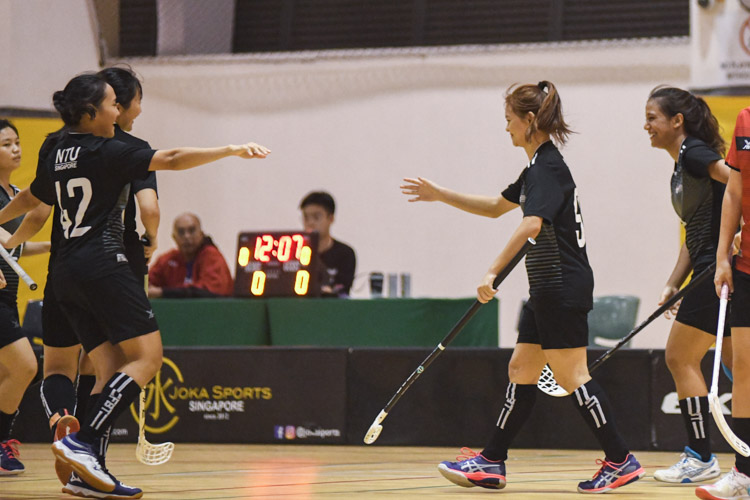 Christy Tay (NTU #99) walking to her teammates to celebrate after scoring a goal. In a top-of-the-table clash, NTU cruised to a 5-0 victory over TP to book their place in the semi-final. (Photo 1 © Stefanus Ian/Red Sports)