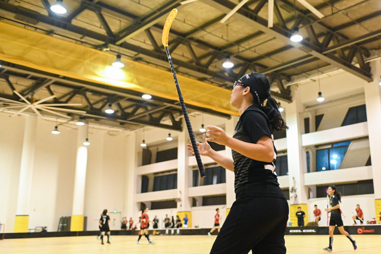 Shannon Yeo (NTU #36, in black) throwing her floorball stick in the air after scoring a goal for NTU. In a top-of-the-table clash, NTU cruised to a 5-0 victory over TP to book their place in the semi-final. (Photo 1 © Stefanus Ian/Red Sports)