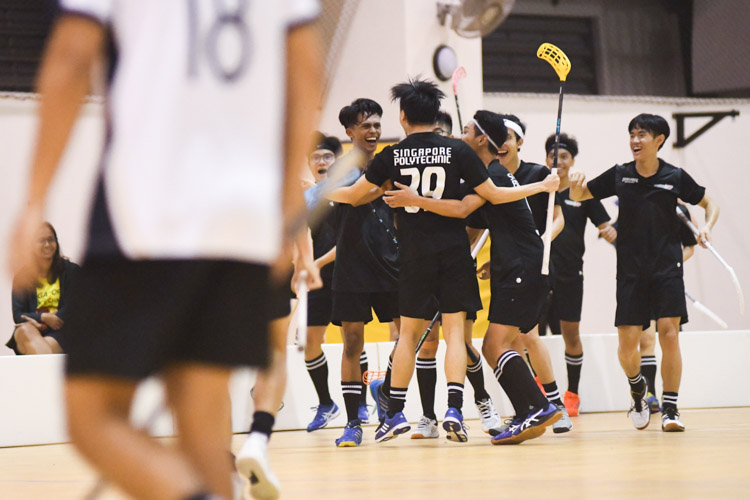 Jover Wee (SP #39) celebrating with his teammates after scoring with a long range shot for his team. Singapore Management University knocked Singapore Polytechnic out of the IVP with a score of 6-2 in their final group match. (Photo 1 © Stefanus Ian/Red Sports)