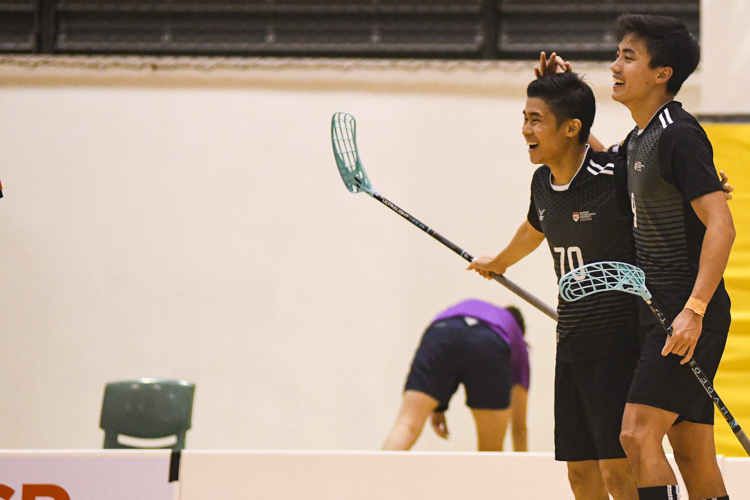 Amshar bin Amin (NTU #9) celebrating his hat-trick with his teammate, Lim Jian Hong (NTU #70). NTU put on an offensive exhibition as they demolished Team ITE, who were POL-ITE champions, with a 6-0 victory to clinch the IVP title. (Photo 1 © Stefanus Ian)