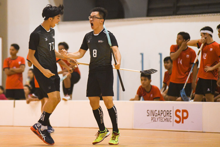 Sean Toh (NTU #8) celebrating one of NTU's goals with his teammate, Thaddeus Tan (NTU #77). NTU put on an offensive exhibition as they demolished Team ITE, who were POL-ITE champions, with a 6-0 victory to clinch the IVP title. (Photo 1 © Stefanus Ian)