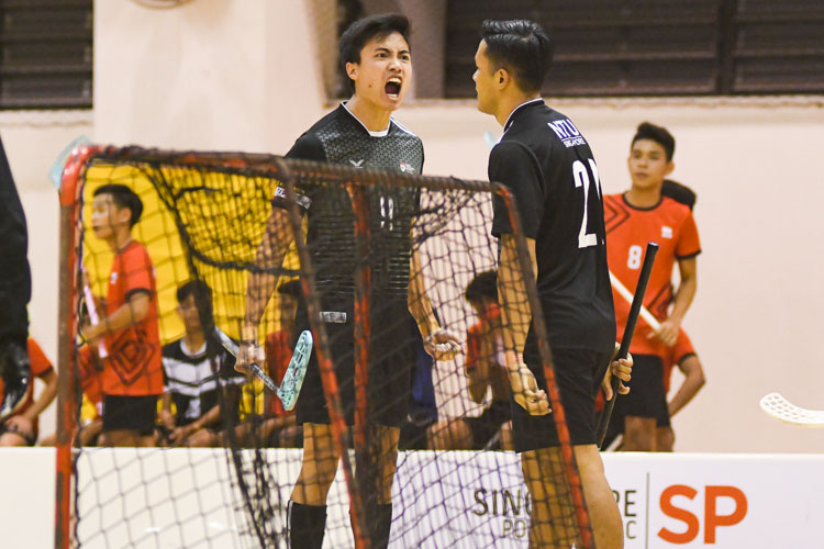 Amshar bin Amin (NTU #9) celebrating his first goal with his teammate Muhammad Jazli bin Yuslane (NTU #21). NTU put on an offensive exhibition as they demolished Team ITE, who were POL-ITE champions, with a 6-0 victory to clinch the IVP title. (Photo 1 © Stefanus Ian)