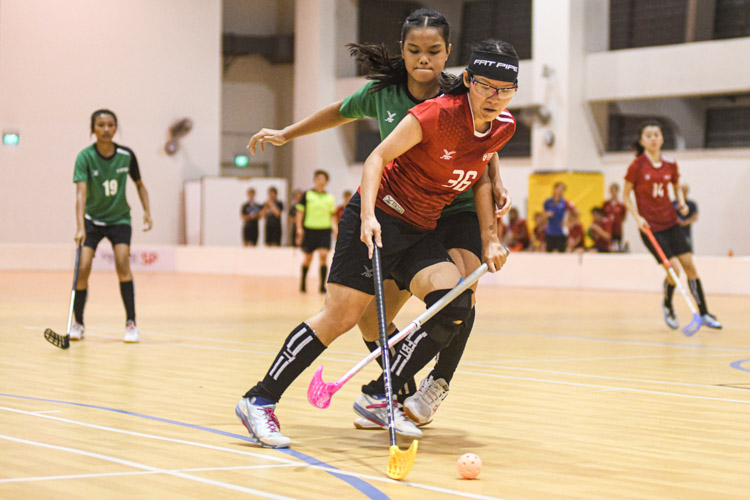 NTU's Shannon Yeo (NTU #36) dribbling with the ball while being tightly guarded by her opponent during the match. Nanyang Technological University completed their Institute-Varsity-Polytechnic (IVP) floorball season in a close-to-perfect run against Republic Polytechnic. The girls in red dominated the match with a 2-0 win as they were crowned 2019/20 IVP champions.(Photo 1 © Stefanus Ian/Red Sports)