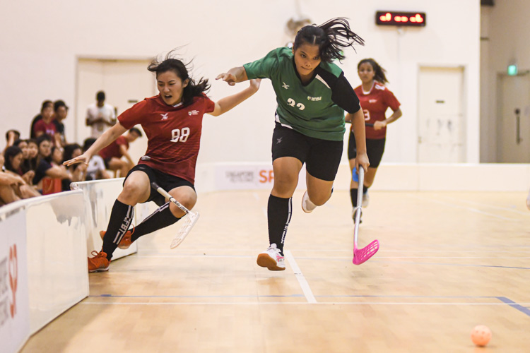 RP's Siti Nur Zulaika (RP #32) brushing off her opponent Emily Ong (NTU #88) into the boards during the match. Nanyang Technological University completed their Institute-Varsity-Polytechnic (IVP) floorball season in a close-to-perfect run against Republic Polytechnic. The girls in red dominated the match with a 2-0 win as they were crowned 2019/20 IVP champions.(Photo 1 © Stefanus Ian/Red Sports)