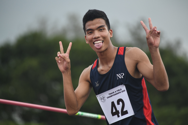Hairul Syamil of NYPposing for the camera after hiswinning jump of 1.96m. He would go on to win the gold with that final height. (Photo 1 © Stefanus Ian/Red Sports)