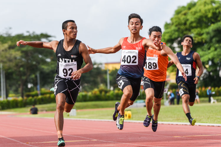 NTU's Khairyll Amri (#92) pips training partner Naqib Asmin (#402) of SUSS by 0.09 seconds as he clinches his third straight IVP Men's 100m gold with a time of 10.80s. (Photo 1 © Iman Hashim/Red Sports)