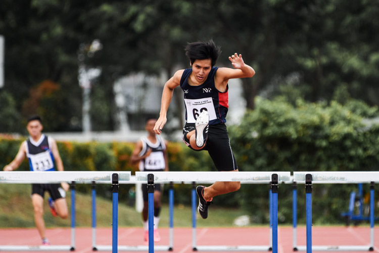 Isaac Toh Beam (#68) of Nanyang Polytechnic claimed the silver medal in the Men's 400m Hurdles with a time of 1:01.03. (Photo 1 © Iman Hashim/Red Sports)