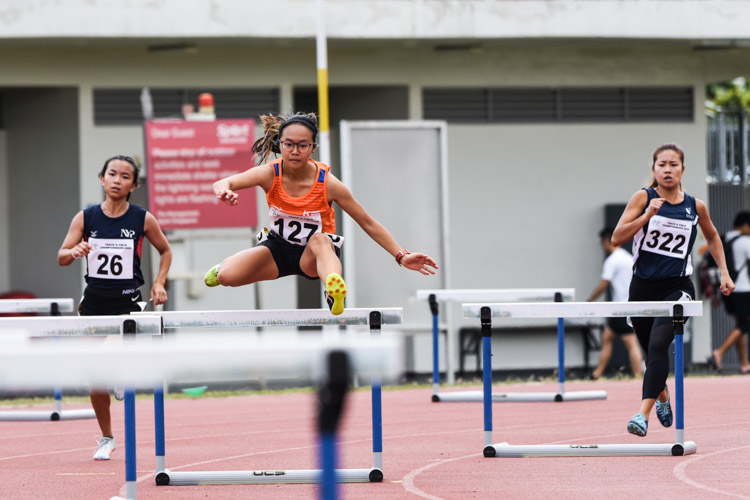 Celeste Goh (#127) of NUS clinched victory in the Women's 400m Hurdles with a time of 1:08.01. (Photo 1 © Iman Hashim/Red Sports)