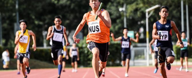 Mitchell Teh (in orange) anchors the National University of Singapore (NUS) quartet to the Men's 4x100m Relay gold, stopping the clock at 43.05 seconds. (Photo 1 © Iman Hashim/Red Sports)