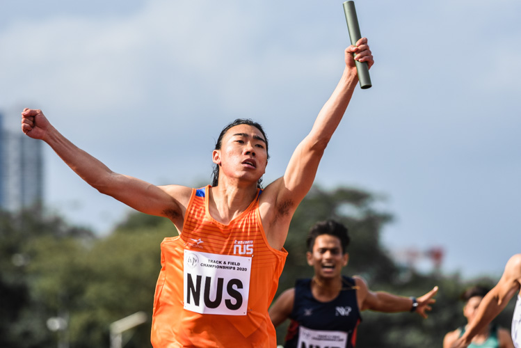 Mitchell Teh of NUS celebrates after anchoring his team to gold in the Men's 4x100m Relay final. (Photo 1 © Iman Hashim/Red Sports)