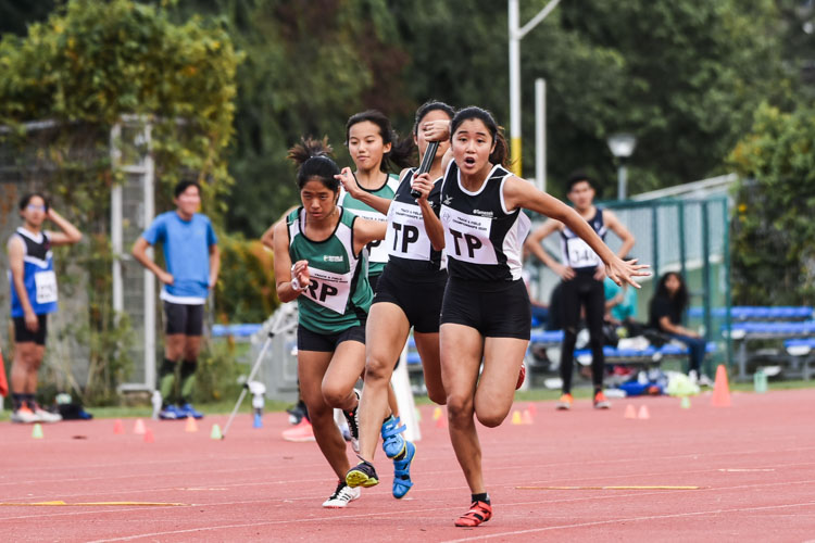 Haanee Hamkah hands over to Clara Goh for Temasek Polytechnic (in black) while Zann Oh passes to Rachel Chin for Republic Polytechnic (in green) between the second and third legs of the Women's 4x100m Relay final. TP clinched gold in 49.73s, while RP took the bronze in 51.89s. (Photo 1 © Iman Hashim/Red Sports)