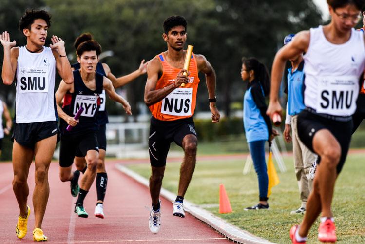 Kishorwaran Selvaraju starts the third leg for NUS in the Men's 4x400m Relay first timed final. (Photo 1 © Iman Hashim/Red Sports)