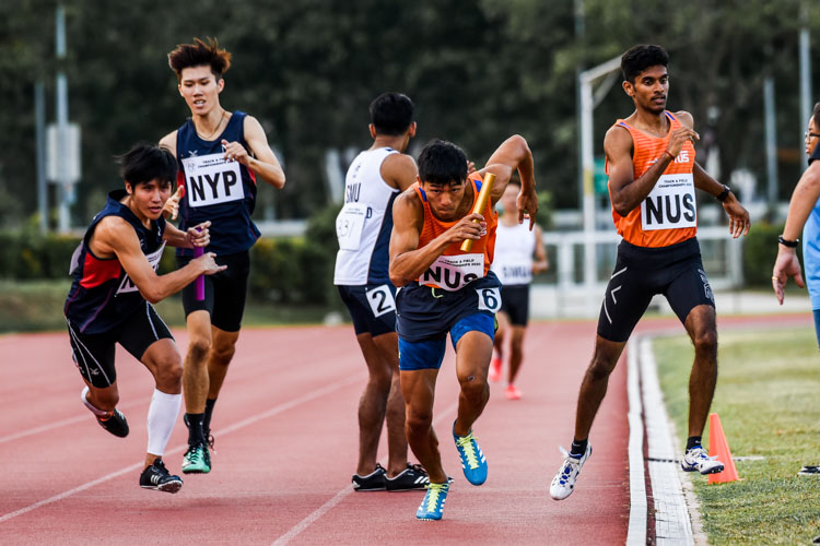 Isaac Toh of NYP and Koh Wei Shien of NUS anchor their respective teams in the Men's 4x400m Relay first timed final. The NUS team clinched gold in 3:32.09, while NYP finished fourth in 3:36.97. (Photo 1 © Iman Hashim/Red Sports)