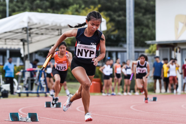 Renee Lum starts the first leg for NYP in the Women's 4x400m Relay timed finals. (Photo 1 © Iman Hashim/Red Sports)