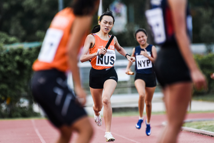Chua Shi Qi of NUS running the second leg for her team in the Women's 4x400m Relay timed finals. (Photo 1 © Iman Hashim/Red Sports)