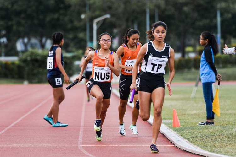 IVP 100m champion Haanee Hamkah of TP and 400m champion Celeste Goh of NUS start the anchor leg in the Women's 4x400m Relay first timed final. (Photo 1 © Iman Hashim/Red Sports)