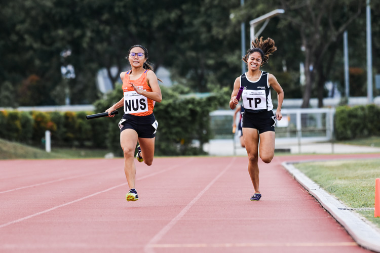 Celeste Goh of NUS pips Haanee Hamkah of TP to the finish line by 0.22 seconds in the Women's 4x400m Relay first timed final. However, NUS and TP settled for silver and bronze respectively overall with timings of 4:22.49 and 4:23.11. (Photo 1 © Iman Hashim/Red Sports)