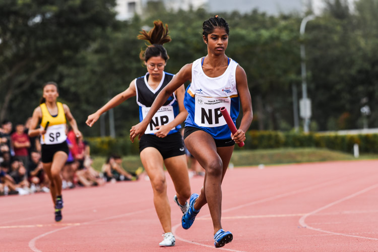Darshini Kuppusamy runs the second leg for NP in the Women's 4x400m Relay second timed final. (Photo 1 © Iman Hashim/Red Sports)