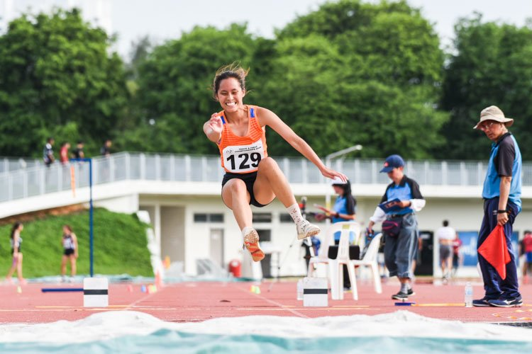 Jezebel Koh of NUS clinched her second gold of the afternoon with a 10.85m leap in the Women's Triple Jump, adding on to her win in the High Jump earlier. (Photo 1 © Iman Hashim/Red Sports)