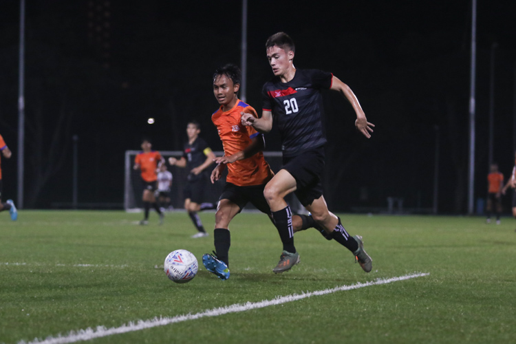Ryhan Euan Griffin (TP #20) speeds past Akmal Bin Fazili (NUS #31) and charges into the penalty area. TP edge out NUS 2-1 to claim IVP Football championship. (Photo 1 © Clara Lau/Red Sports)