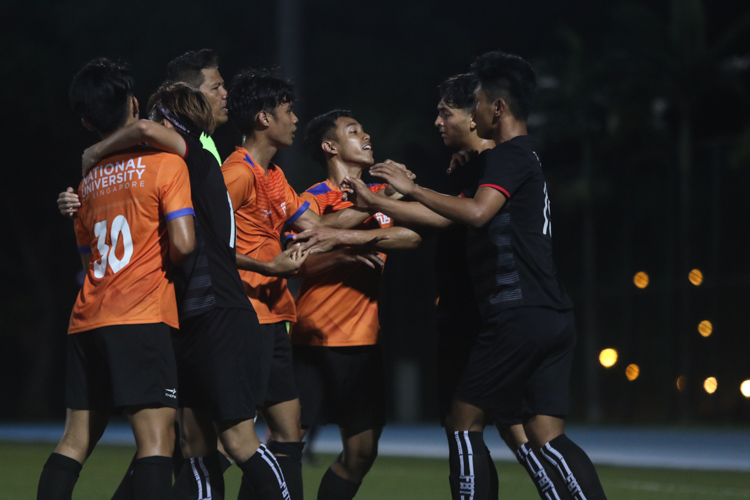 TP and NUS players caught up in an aggressive exchange as the match intensified. TP edge out NUS 2-1 to claim IVP Football championship. (Photo 10 © Clara Lau/Red Sports)
