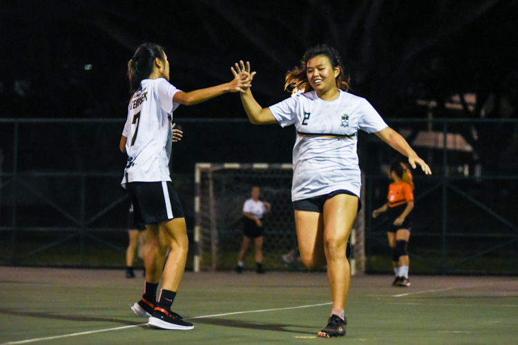 Temasek Hall's Arielle Chiang (#2) and Selina Ang (#7) celebrate a goal during the Women's IHG Handball final against Sheares Hall. (Photo 1 © Iman Hashim/Red Sports)