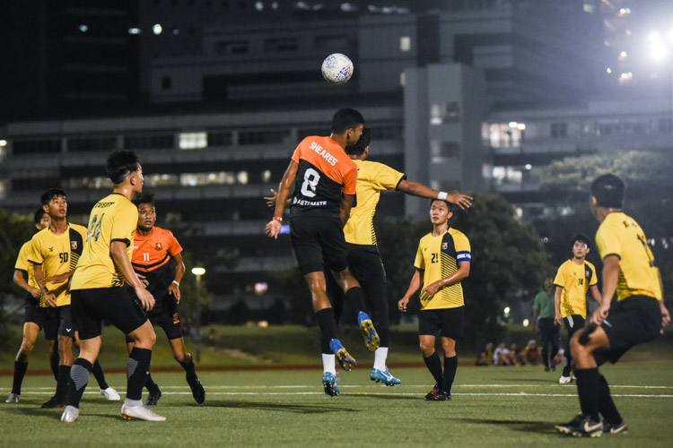 Shamir Robinson (SH #8) rises highest for the corner kick. (Photo 1 © Iman Hashim/Red Sports)