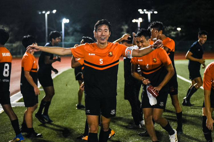 Samuel Kong (SH #5) celebrates with his teammates after securing Sheares' third IHG football title in four years. (Photo 1 © Iman Hashim/Red Sports)